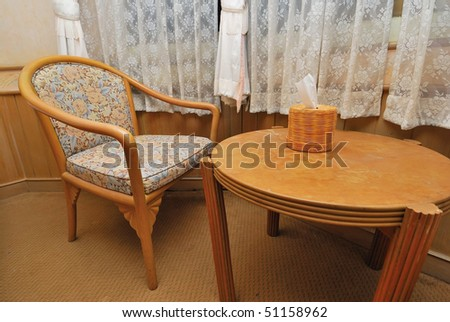 Tea table and chair in high class hotel room. Suitable for concepts such as travel, tourism, vacation and holiday.