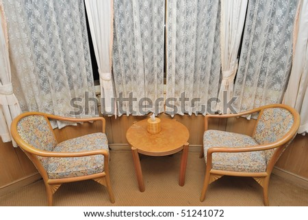 Tea table and chairs for resting in high class hotel room. Suitable for concepts such as travel, tourism, vacation and holiday.
