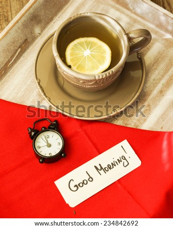 Tea time, cup of tea with lemon and Good morning note