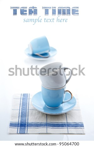 Tea Time - stacked tea cups and serviette
