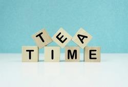 TEA  TIME Text on Wooden Blocks.