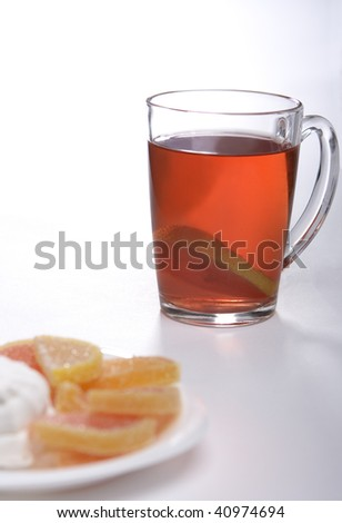 Tea with a lemon and fruit candy