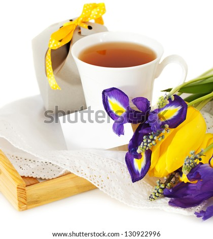 Tea with flowers and gift box for mom in Mother\'s Day