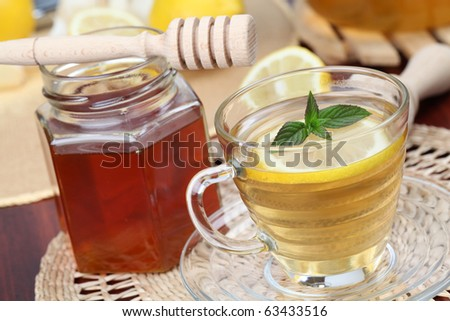 Tea with honey and lemon as natural medicine. Shallow dof
