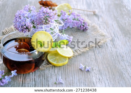 tea with lemon and sugar and flowers #271238438