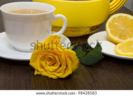 Tea with lemon and yellow rose.