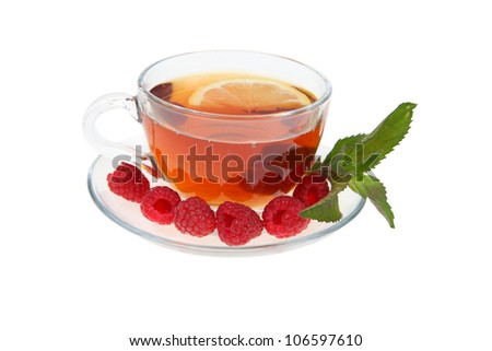 Tea with raspberries and mint isolated on white background