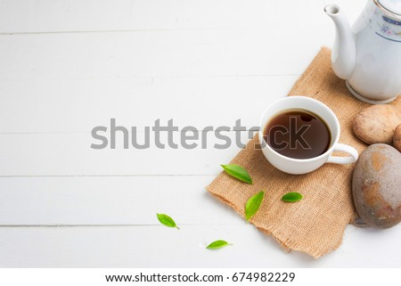 tea with  Tea glass on white wood #674982229