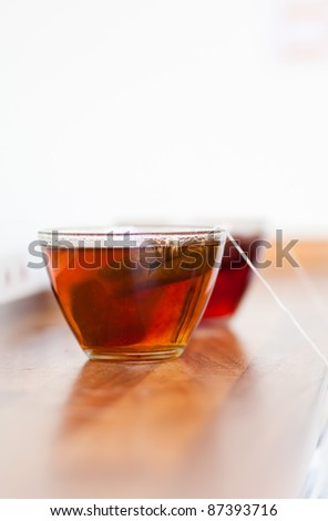 Teabag in a glass cup - stock photo