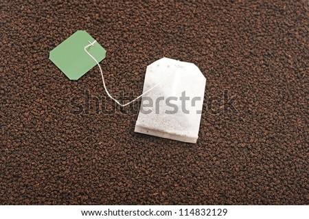teabag on black tea background