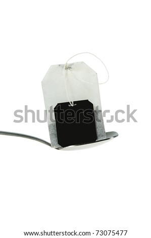 teabag with spoon isolated on white
