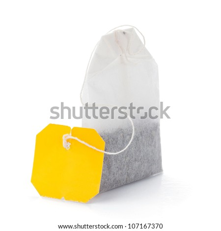 Teabag with yellow label. Isolated on white background