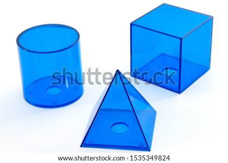 Teach geometry lesson, math exam and mathematical formula for volume conceptual idea with blue plastic pyramid, cube and cylinder isolated on white background