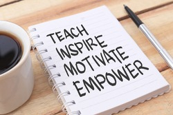 Teach inspire motivate empower, text words typography written on paper against wooden background, life and business motivational inspirational concept