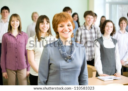 Teacher and a group of students in the classroom