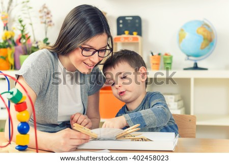 Teacher and Child Playing And Learning at Classroom