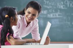 teacher and girl at laptop (horizontal)