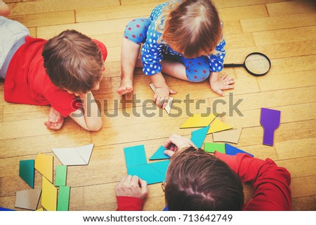 Stock Photo teacher and kids playing with geometric shapes