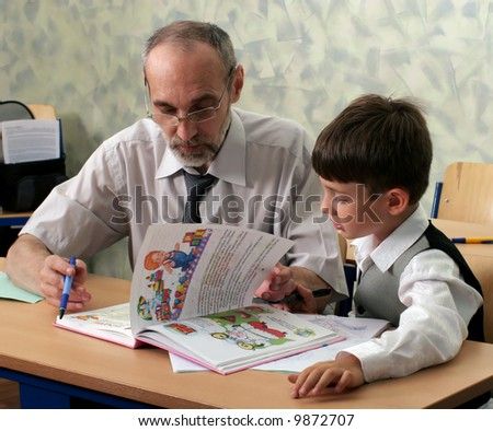 Teacher and pupil with alphabet