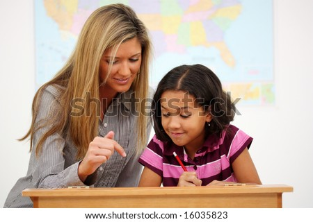 Teacher and Student In A Classroom At School