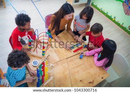 Teacher and student in an international preschool play a toy togather, this concept can use for eduction, kid, student, bob, work and teacher concept Stock foto ©