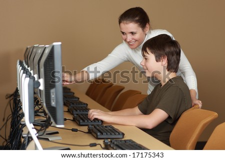 Teacher and student in computer lab