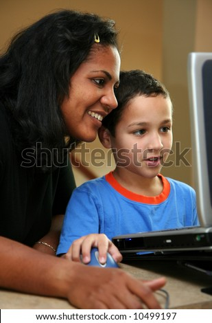 Teacher and student on the computer