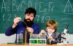 Teacher child test tubes. Cognitive process. Kids cognitive development. Mental process acquiring knowledge understanding through experience. Chemistry experiment. Back to school. Cognitive skills.