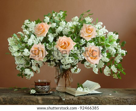 Teacher day (huge bunch of white spring flowers and roses,open book and cup of black tea)