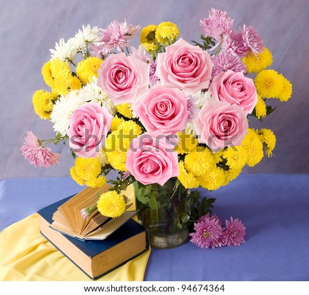 Teacher day (still life with books and bunch of pink roses and asters)
