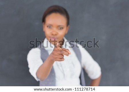 Teacher finger-pointing in a classroom