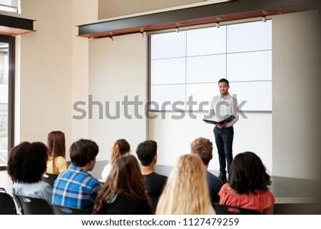 teacher giving presentation to...