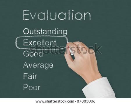 teacher hand evaluate excellent on chalkboard