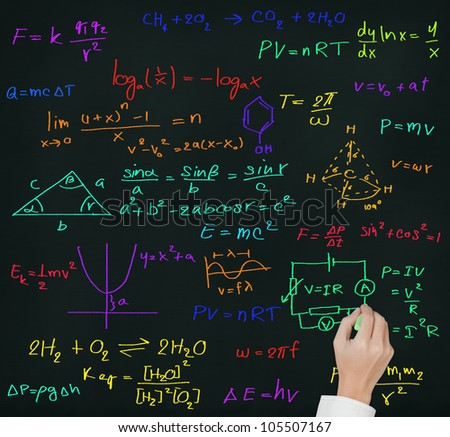 teacher hand writing high school maths and science formula on blackboard