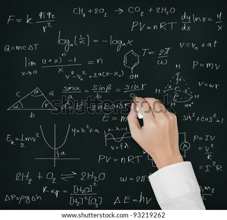 teacher hand writing various high school maths and science formula on blackboard