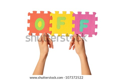 teacher holding in the hand the amusing colored educational puzzles with the word off