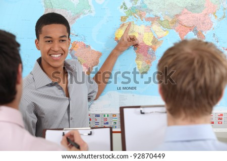 Teacher in geography class