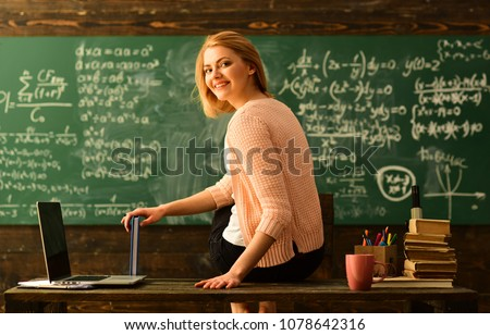 Teacher is skilled leader, Student looks for studying method that suits his learning style, Modern teacher hipster writing on big blackboard with math formula, Some students learn best by listening, #1078642316