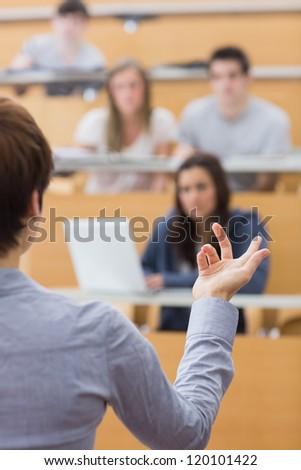 Teacher is talking to the students at the lecture hall