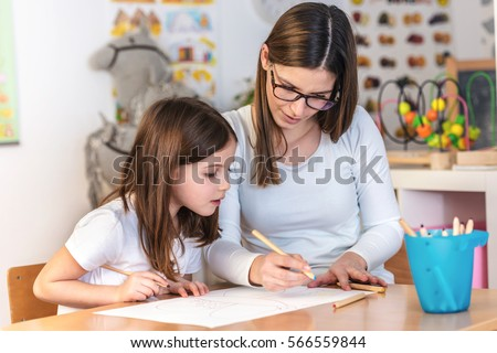 Teacher Mom working with Creative Kid #566559844
