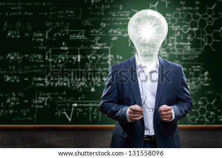 Teacher or college professor with a light bulb head in front of a chalkboard with complex math problems.