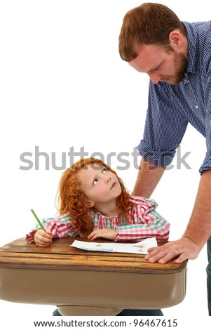 Teacher or Father Helping Elementary Student at Desk over White Background