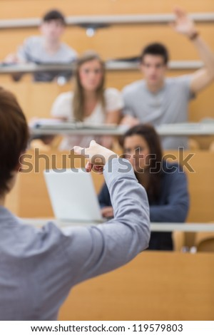 Teacher pointing to the man at the lecture hall