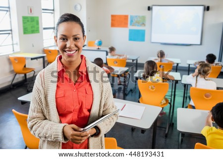 Teacher posing with her tablet at school #448193431