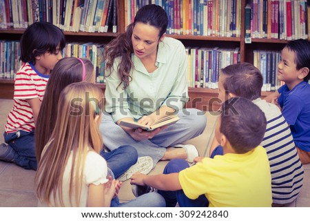Teacher reading her pupils a story at the elementary school