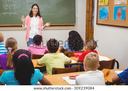 Teacher teaching her classroom of students at the elementary school