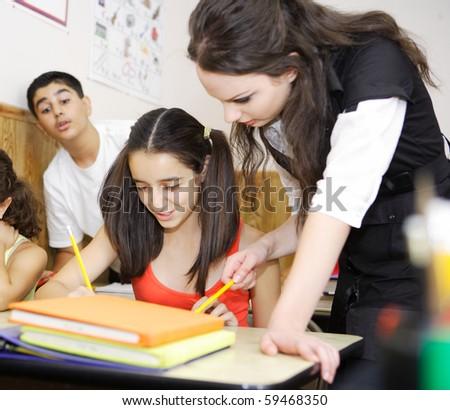 Teacher teaching while student cheating - stock photo