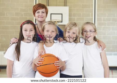 Teacher With Girls School Basketball Team