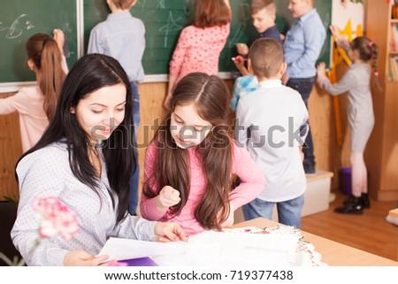 Teacher with pupils during a break #719377438