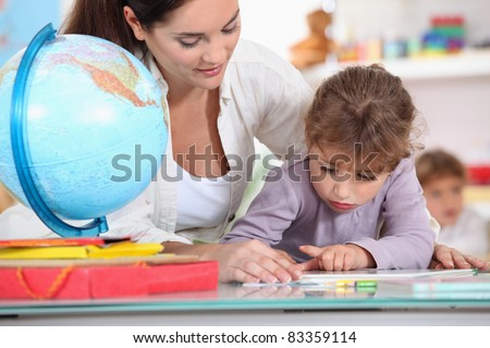 Teacher with pupils in class - stock photo